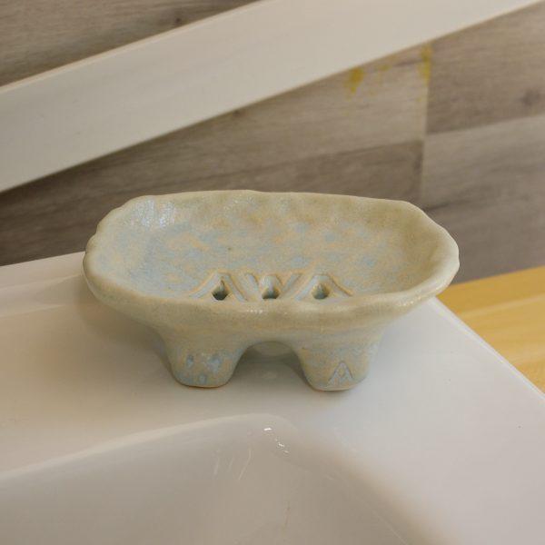 Seafoam soap dish on Bathroom sink